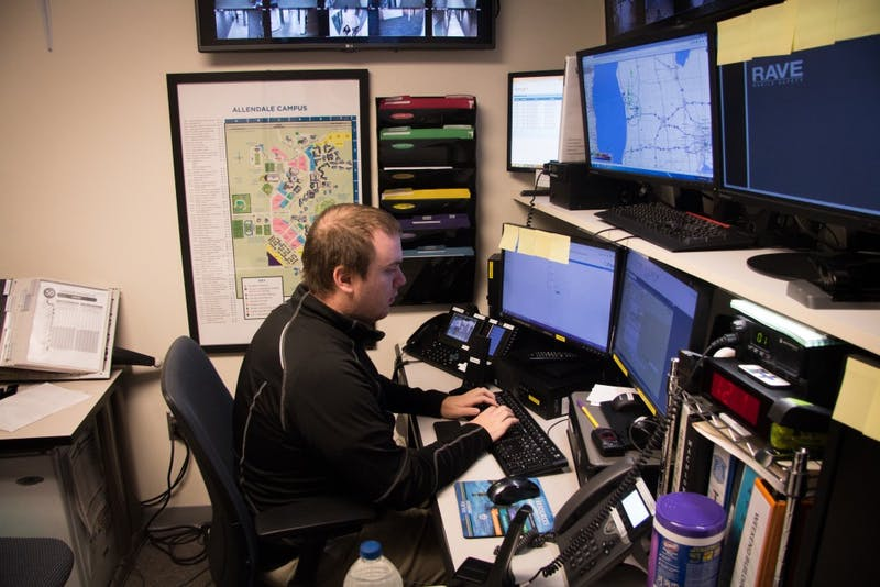 GVL / Spencer Scarber Grand Valley State Emergency operator (name redacted) performing daily tasks at Grand Valley Police Department disbatch center on October 3rd, 2017
