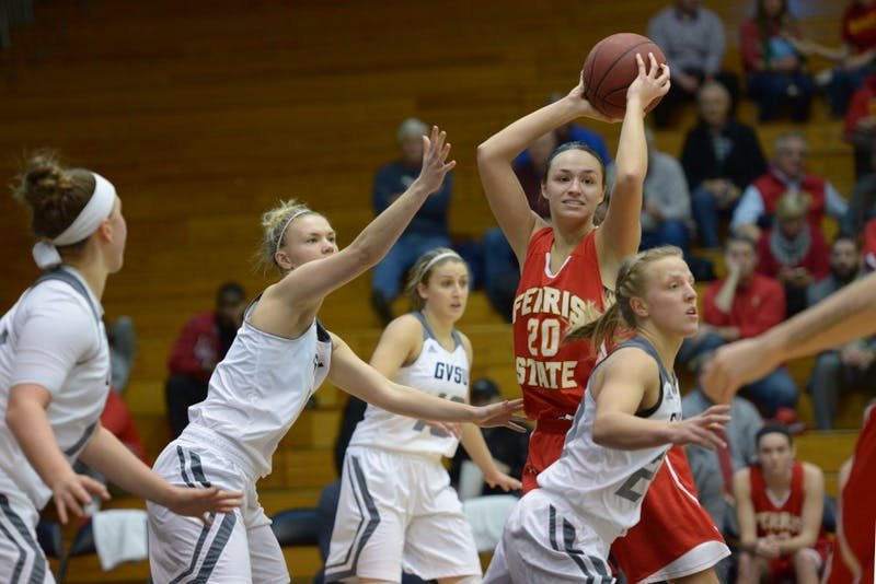 GVL / Luke Holmes - Piper Tucker (11) plays defense as her opponent tries to pass the ball. GVSU Women's Basketball defeated Ferris State University on Monday, Jan. 30, 2016.