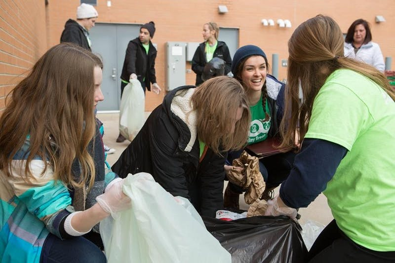 Courtesy / Green Team Green Team volunteers sort waste from campus dining facilities.