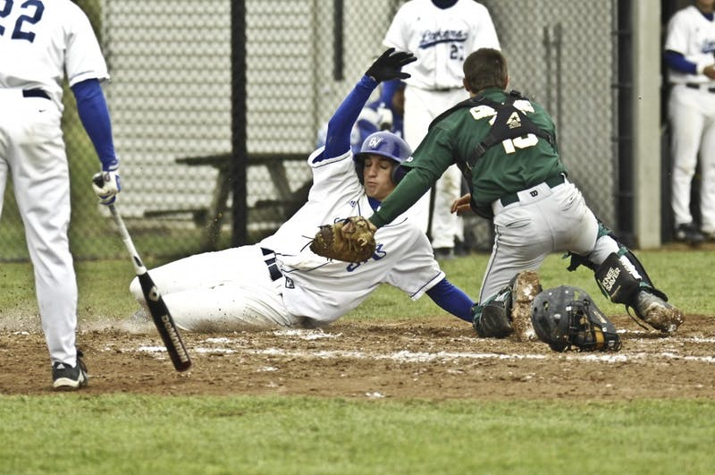 GVL Archive / Andrew MillsGrand Valley State University freshmen Steve Anderson is tagged out at home during Tuesday