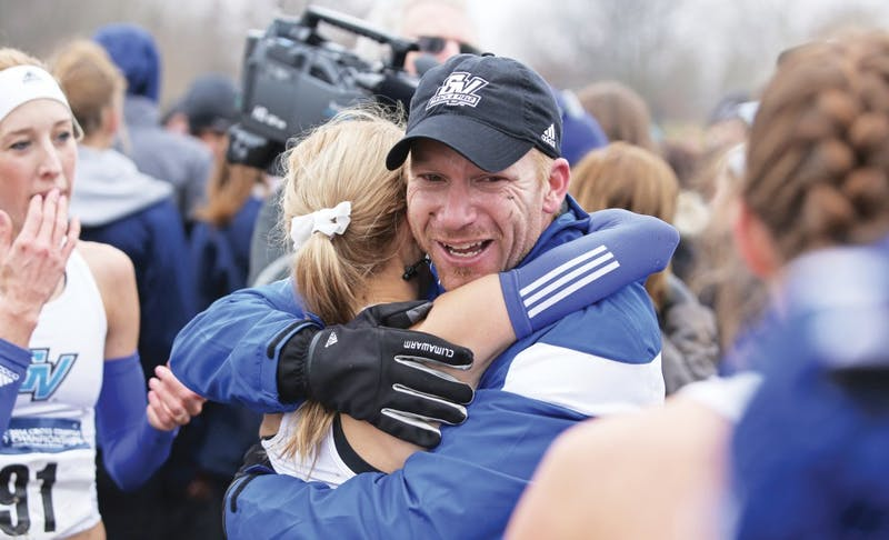 GVL/Kevin Sielaff - Jerry Baltes celebrates a victory with his team during the 2014 Cross Country National Championships in Louisville, KY.