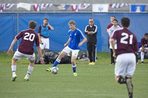 GVL/Kevin SielaffNoah Reiber dribbles around a defender. Grand Valley's club soccer team squares off against Central Michigan Sept. 12 at the intramural field.