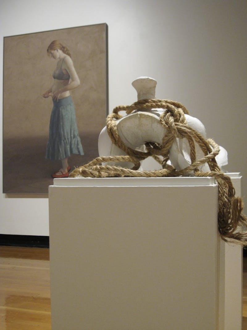 """Courtesy Photo / Paris TennenhouseImage from MultiMedia I exhibition showing: Anna Campbell's, """"Saddedstair"""", plaster and rope, 2007 and Ed Wong Ligda's, """"Lily Injecting Fertility Drug""""' oil on canvas, 2009."""