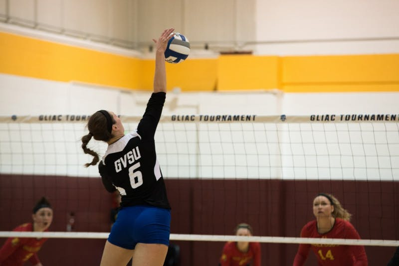 GVL/Luke HolmesBetsy Ronda (no.6) jumps up to spike the ball. Grand Valley lost to Ferris State in 3 games Nov. 21.
