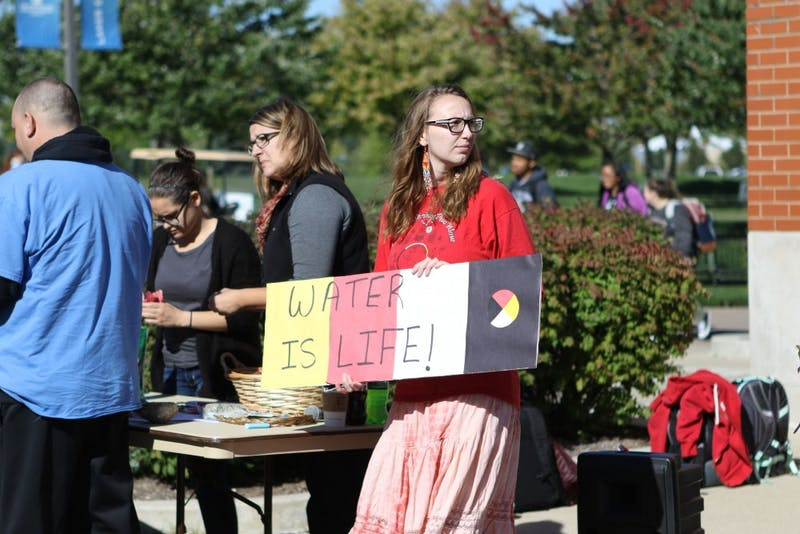 "GVL / Luke Holmes - The ""Water is Life"" awareness rally was held right next to the clock tower on Monday, Oct. 10, 2016."