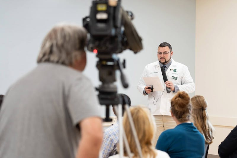 John Westfall, second-year medical student and GVSU graduate, makes remarks during a news conference July 23 that outlined an early assurance of admission program. Courtesy / gvsu.edu