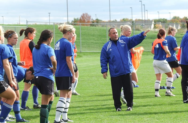 GVL Archive / Taylor RaymondGirls head soccer coach Dave DiIanni tells players what to focus on before their scrimmage during practice.