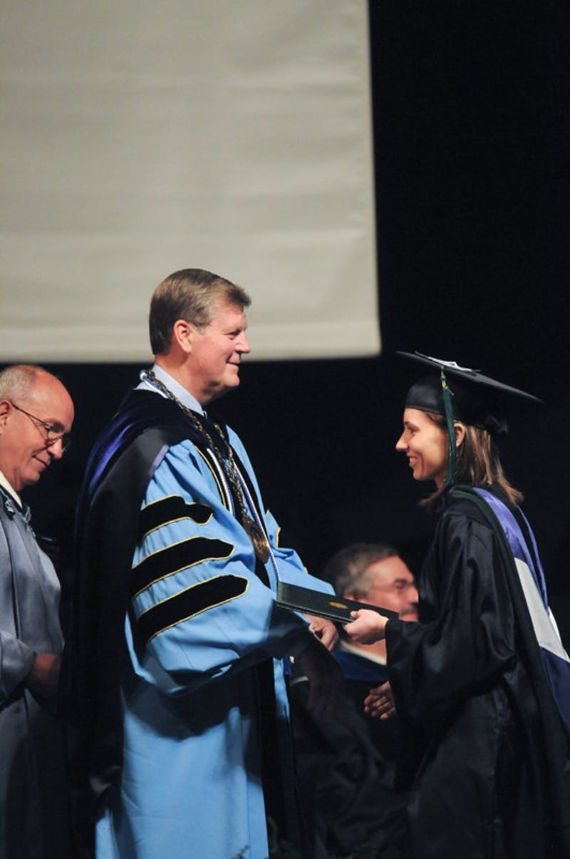GVL Archive  President Haas offers a diploma to a graduate during commencement