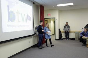 GVL / Emily Frye   Club leaders Alan Carter and Amber Modena talk about future events during the first meeting of the Bringing Together the World Club on Tuesday January 16, 2018.