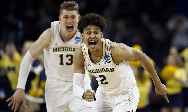 ap_ncaa_houston_michigan_basketball_98521354-e1521348608468.jpg
