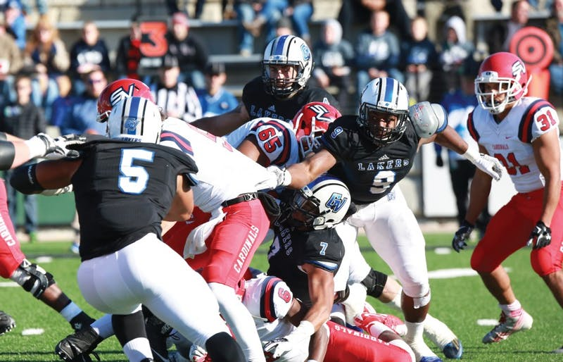 GVL / Kevin Sielaff - Matt Judon (9) gets a hand on SVSU's QB before he is tackled to the ground.  Grand Valley squares off against SVSU Nov. 14 in Allendale. The Lakers hold on and win with a final score of 24-17.