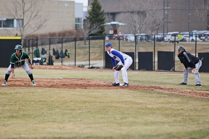 GVL / Emily FryeRyan Blake-Jones keeps an eye on the pitch while holding down first base during the home opener game against Tiffin on Thursday March 29, 2018.