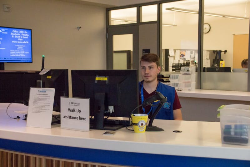 GVL / Dylan McIntyre. Tuesday, Oct. 3rd, 2017. Cody Chinn, IT worker at Mary Idema Pew waiting to help studetnts with questions and software issues.