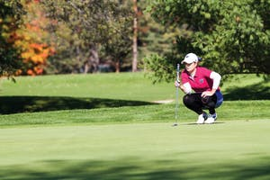 GVL / Sara Carte - Samantha Moss lines up her putt during the Davenport Invitational at the Blythefield Country Club on Monday, Oct. 26, 2015.