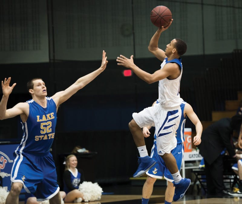 GVL/Luke Holmes - Myles Miller (12) jumps up for the shot as Grand Valley had squares off againt Lake Superior State on Thursday, Feb. 12, 2016 in Allendale.