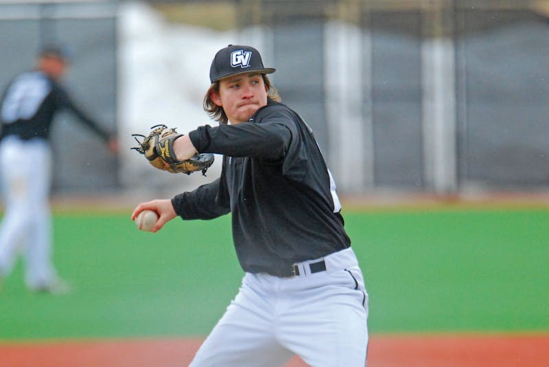 GVL / Hannah MicoSophomore Patrick Kelly pitches against Wayne State University on Saturday; the Lakers defeated WSU 3-0.
