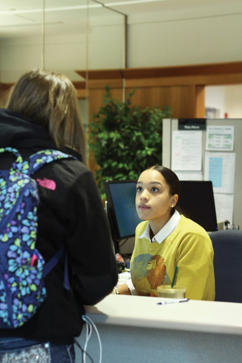 GVL/Archive - Sydney Wiltshire helps a student in the Financial Aid office on Thursday, Feb. 26, 2016 in Allendale.