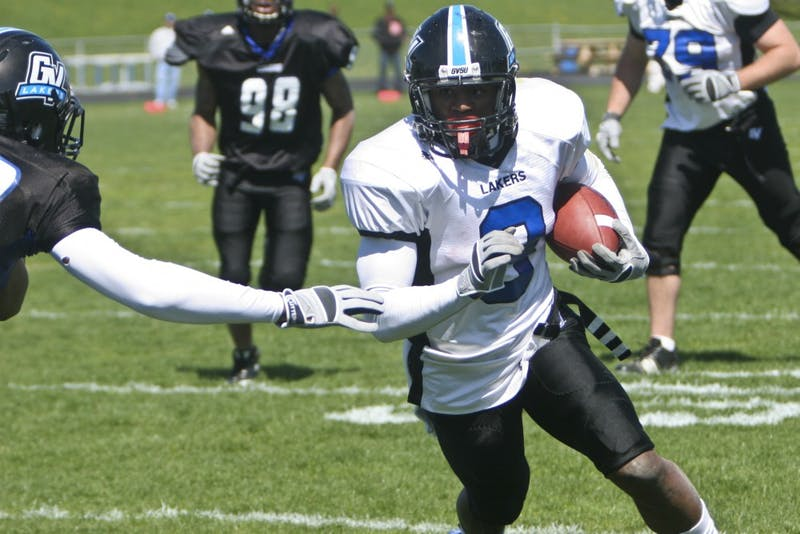 Freshman Norman Shuford blows past defenders during the GVSU Spring Game.