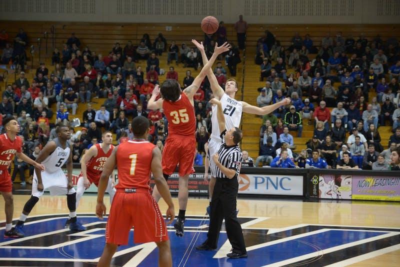 GVL / Luke Holmes - Drake Baar (21) jumps for the jump ball. GVSU Men's Basketball lost to Ferris State University on Monday, Jan. 30, 2016.