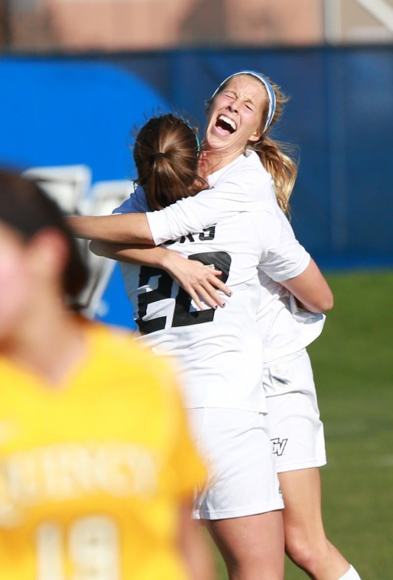 GVL / Kevin Sielaff - Katie Klunder (2) and Samantha Riga (22) celebrate a goal.  Grand Valley squares off against Quincy in the second round of the women's soccer NCAA tournament Nov. 15 in Allendale. The Lakers take the victory with a final score of 6-0.