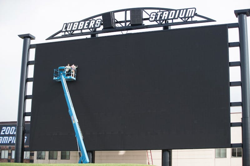 GVL / Kevin Sielaff - Workers put the final touches on Lubbers Stadium's new video board. Grand Valley State football hosts its annual media day at Lubbers Stadium on Thursday, August 25, 2016.