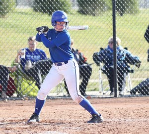GVL/Kevin Sielaff - Jenna Lenza (4) prepares to take a swing during the game vs. Lewis on Tuesday, March 28, 2017.