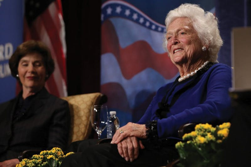 GVL / Robert MathewsFormer First Ladies Barbara and Laura Bush answers questions from moderator David Ferriero during the Gerald R. Ford Museum First Ladies Luncheon on Monday in the JW Marriott ballroom.