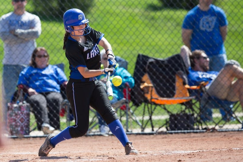 GVL / Kevin Sielaff – Shannon Flaherty (19) makes contact with the ball and runs to first base. Grand Valley takes the victory over Walsh in both games held in Allendale on Saturday, April 23, 2016.
