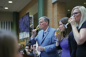 GVL / Emily FryePresident Thomas Haas, Ella Fritzemeier, and Sarah Daniels toast with the class of 2017 on Wednesday April 19, 2017.