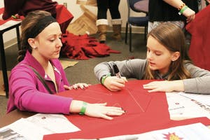 GVL/Emily Frye - Karly (left) and Kenzie Brouwer (right) participate in craft activities during Sibs n' Kids weekend Friday, Jan. 30, 2015.