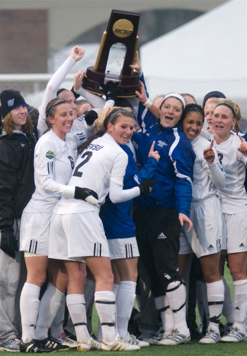 The women's soccer team celebrates their second national title