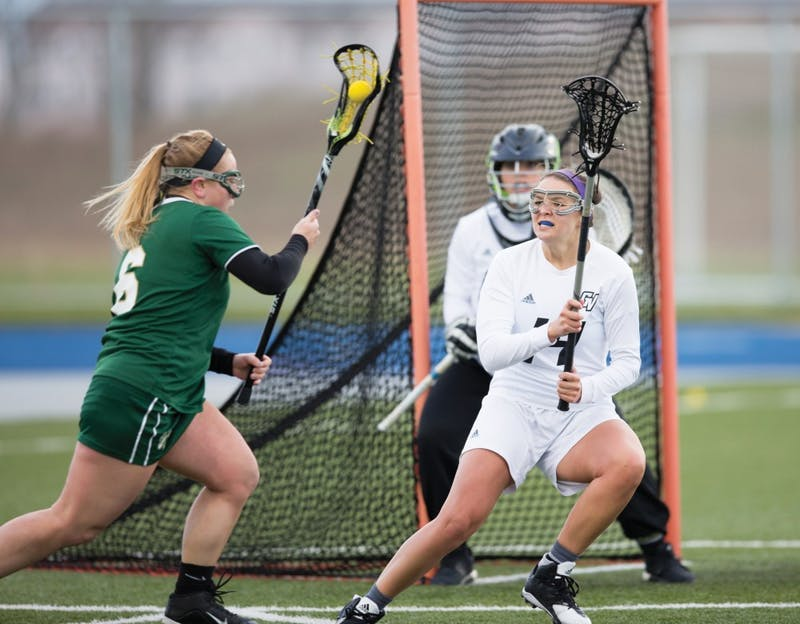 GVL / Kevin Sielaff – Chloe Zdybel (14) defends Grand Valley's net. The Lakers take the victory over Tiffin University Friday, April 1, 2016.