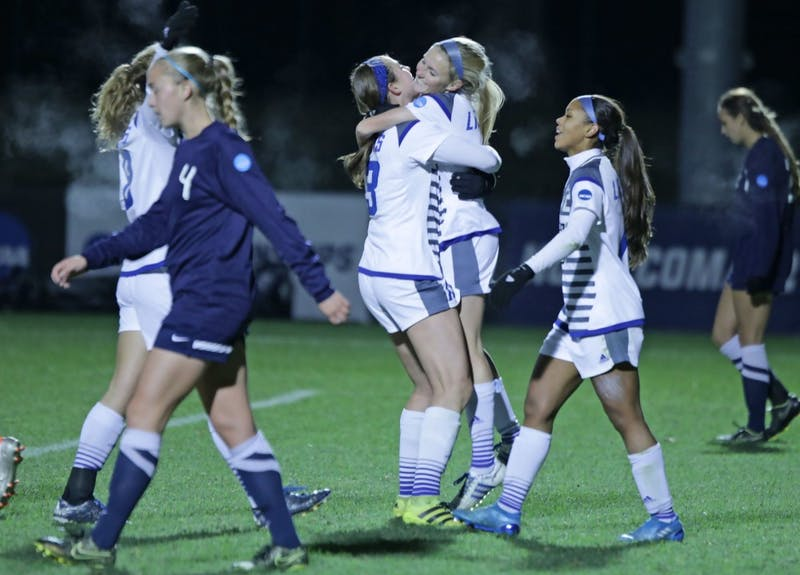 GVL / Emily Frye The Grand Valley State Lakers celebrate after the third goal of the semi finals scored by Kendra Stauffer during the first half of the game on Thursday Dec. 1, 2016.