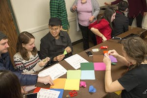 GVL / Sara CarteGrand Valley State University students make origami during the celebration of the Asian New Year Festival 2016, sponsored by the Asian Student Union and the Office of Multicultural Affaris, in the Kirkhof Center on Thursday, Feb. 4, 2016.
