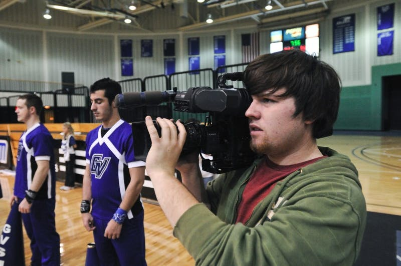 Andrew Murray, both a GVSU student and WGVU employee, films a basketball game in the Fieldhouse.