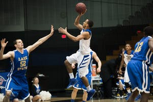 GVL / Luke Holmes - Myles Miller (12) jumps up for the shot. Grand Valley had a victory over Lake Superior State Thursday, Feb. 12, 2016.