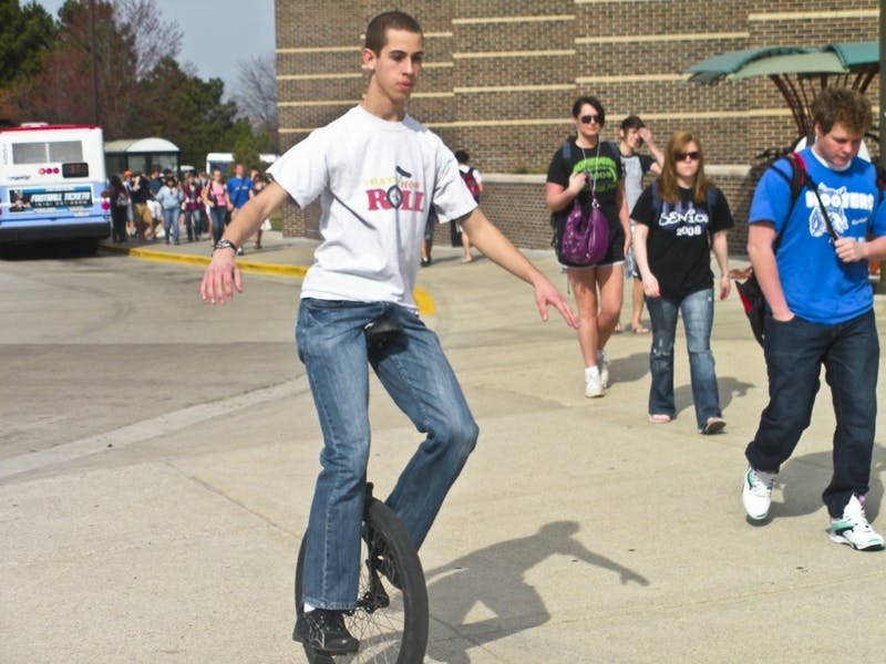 Josh Sutton rides his unicycle around campus. He started the hobby five years ago.