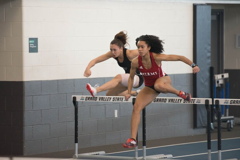 GVL / Luke Holmes - Breanna Luba jumps over the hurdle. The GVSU Big Meet was held in the Kelly Family Sports Center on Friday, Feb. 10, 2016.