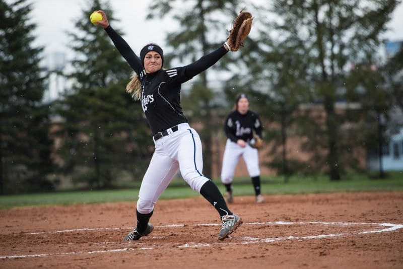 GVL / Luke Holmes - Courtney Reinhard (7) winds up to throw the pitch. Grand Valley State University defeated Northwood University in both games at the Grand Valley softball field Thursday, Apr. 7, 2016.