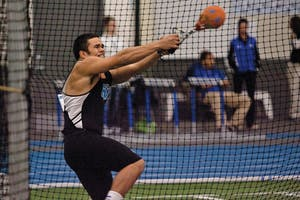 Darien Thornton competes in a 2014 weight throw event in Allendale.