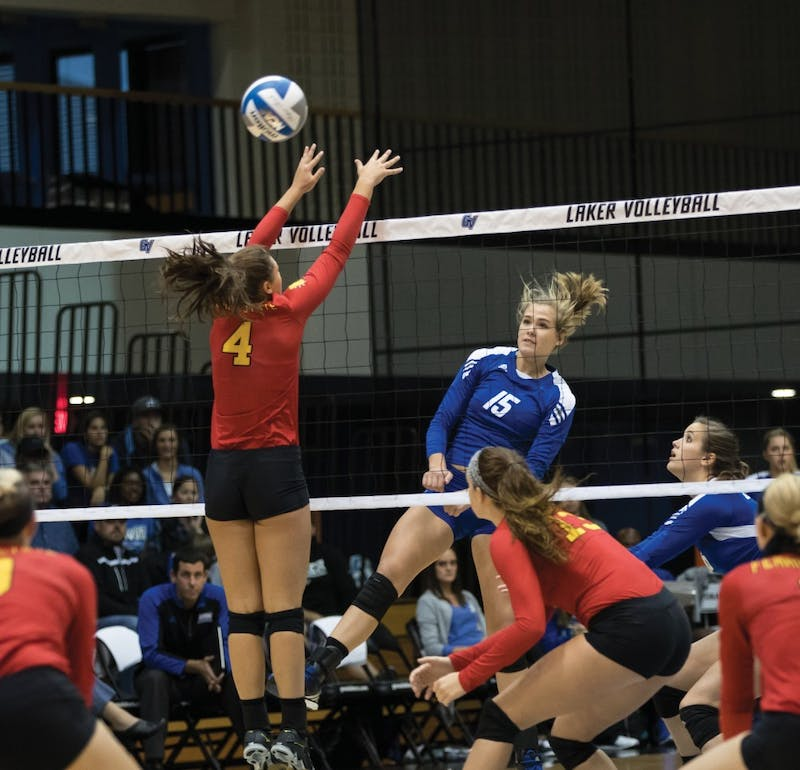 GVL/Kevin Sielaff - Jayci Suseland (15) spikes the volleyball over the net and past a Ferris blocker. The Lakers fall to the Bulldogs of Ferris State with a final score of 1-3 Tuesday, Sept. 27, 2016 in Allendale.