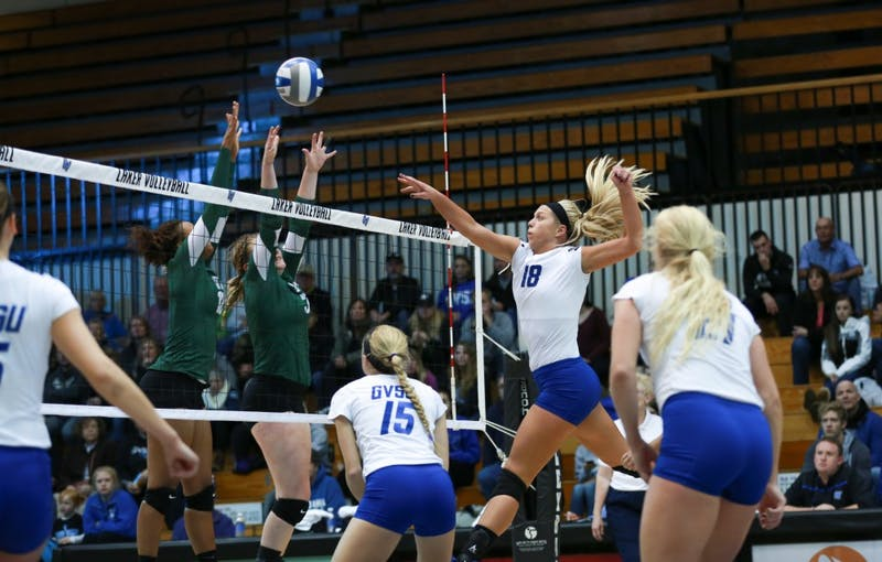 GVL / Kevin Sielaff - Shannon Winicki (18) tips the ball over the net. Grand Valley sweeps Tiffin Oct. 3 after three sets inside the Fieldhouse Arena in Allendale.