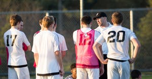 GVL / Kevin Sielaff - Head coach Jeff Crooks speaks to his men at halftime. Grand Valley's men's club soccer team falls to GRFC with a final score of 2-0 on Friday, April 15, 2016.