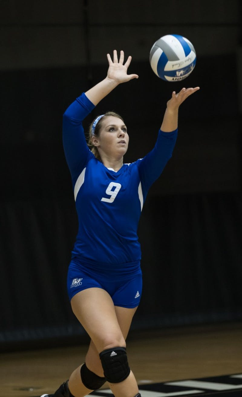 GVL/Kevin Sielaff - Katie Olson (9) serves the ball. The Lakers fall to the Bulldogs of Ferris State with a final score of 1-3 Tuesday, Sept. 27, 2016 in Allendale.
