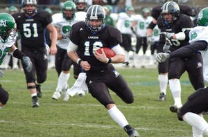 Former Laker Quarterback Cullen Finnerty runs the ball against North Dakota during his senior season. GVL / Archive