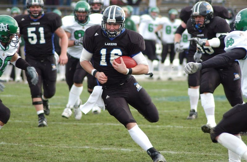 Former Laker Quarterback Cullen Finnerty runs the ball against North Dakota during his senior season.   GVL / Archive