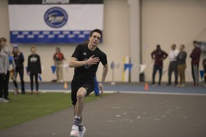 GVL / Luke Holmes - Hunter Weeks gets a running start before high jumping. The GVSU Lints Alumni Meet was held in the Kelly Family Sports Center on Saturday, Jan. 29, 2017.