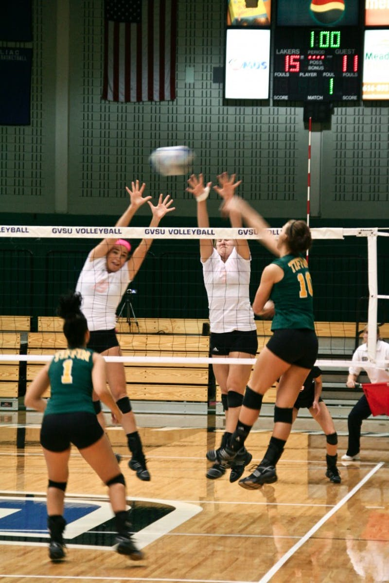 Stacey Catalano and Nicole Whiddon jump to block the return from Tiffin