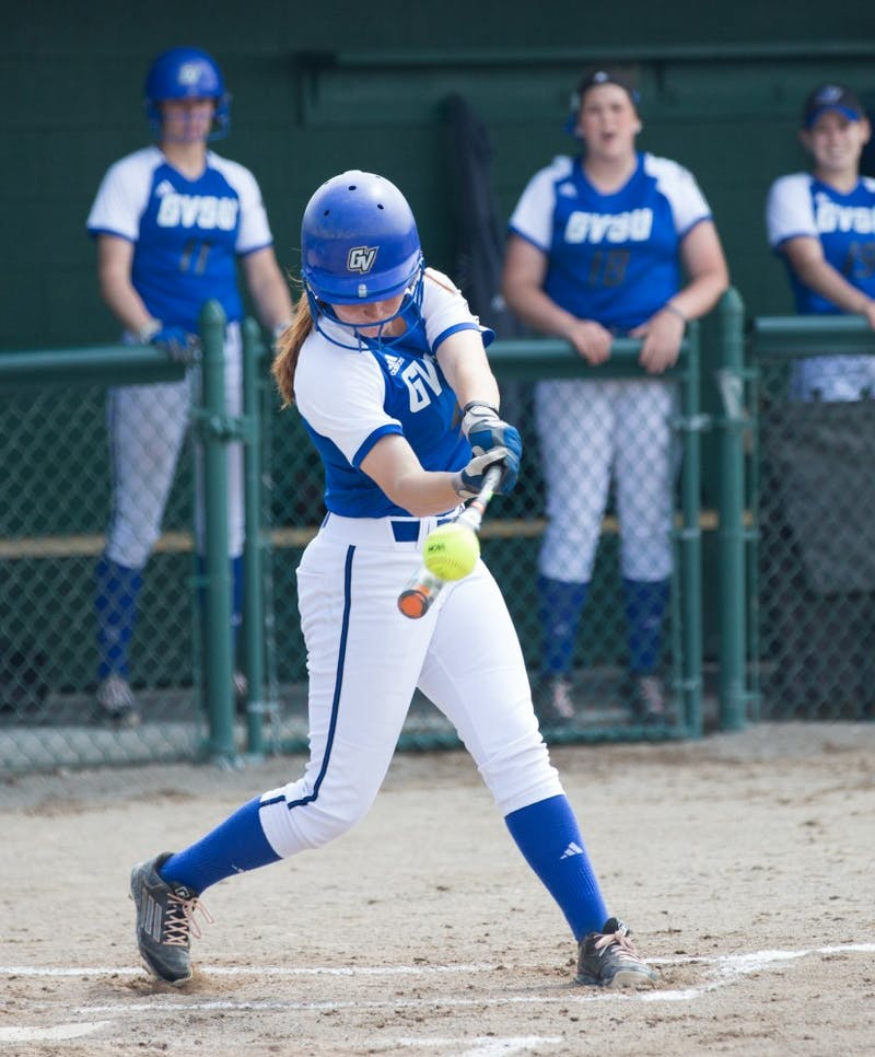 GVL / Kevin Sielaff - Jenna Lenza (4) hits the ball high and down field. Grand Valley State squares off against Wayne State in the second game of the Midwest Super Regional tournament. The Lakers came out with the victory with a final score of 1-0 on Thursday, May 12, 2016 in Detroit, MI.