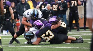 GVL / Kevin Sielaff - Brandon Revenberg (57) makes the tackle on an Eagle offensive drive.  Grand Valley defeats Ashland with a final score of 45-28 Nov. 22 at Ashland University.